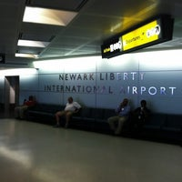 Photo taken at Newark Liberty International Airport (EWR) by Alexander B. on 7/4/2013