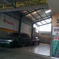 Photo taken at Pilar Tidar Car Wash by Galih P. on 5/8/2013