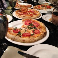 Photo taken at Colosseo Ristorante & Bar Italiano by Traiko T. on 10/19/2014