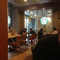 Photo taken at Starbucks by Walaiporn L. on 4/20/2013