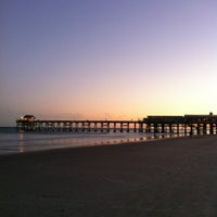 Photo taken at Cocoa Beach Pier by Nicole M. on 12/21/2012