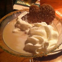 Photo taken at Outback Steakhouse by Nicole M. on 12/9/2012