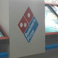 Photo taken at Dominos pizza by Queenie G. on 2/18/2014