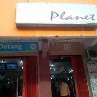 Photo taken at Planet 2000 by Kiki L. on 8/12/2013
