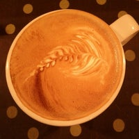 Photo taken at Uncommon Grounds Coffee & Tea by Ann Z. on 9/24/2012
