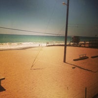 Photo taken at Palm Beach Park - Poche Beach by Levar J. on 7/16/2014