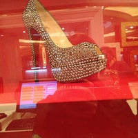 Photo taken at Christian Louboutin by Irlanda T. on 2/24/2013