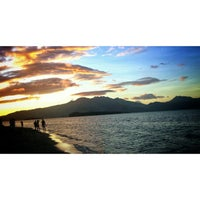 Photo taken at Beach View, Camayan Beach Resort by Jr O. on 11/26/2014