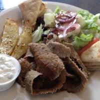 Photo taken at Mykonos Grill by Gwen S. on 6/26/2013