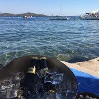 Photo taken at Doria Beach by Evrim ç. on 7/8/2017
