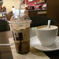 Photo taken at The Parisian Cafe by Ravikanth R. on 3/5/2014