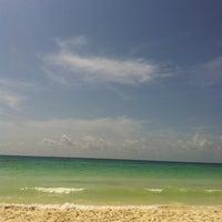Photo taken at Playa Xaman-Ha by Denisse D. on 6/16/2013