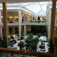 Photo taken at Crocus City Mall by Karina V. on 9/30/2012