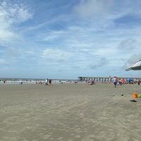 Photo taken at Isle of Palms Beach by Richard F. on 7/5/2013