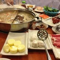 Photo taken at La Mei Zi Restaurant (辣妹子火锅) by MunYee on 2/25/2013