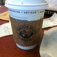 Photo taken at Einstein Bros Bagels by Erin E. on 2/19/2011