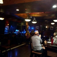 Photo taken at Molly Maguire's Irish Restaurant & Pub by Carlton W. on 7/22/2012