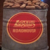 Photo taken at Logan's Roadhouse by Kevin M. on 12/27/2010