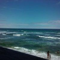 Photo taken at Praia de Ipitanga by Aviva O. on 1/19/2012