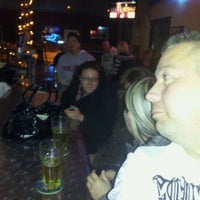 Photo taken at Throwbacks Grille & Bar by Adam J. on 1/14/2012