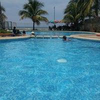 Photo taken at Punta Roca by Mario G. on 7/28/2012