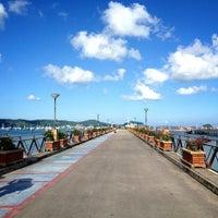 Photo taken at Chalong Bay Pier by Alena K. on 5/20/2012