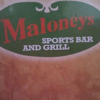 Photo taken at Maloney's Sports Bar & Grill by Molly M. on 10/9/2011