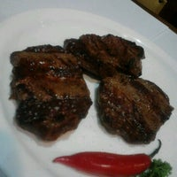 Photo taken at Parrilla Argentina by Mauricio T. on 7/20/2012