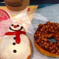 Photo taken at Krispy Kreme Doughnuts by maaaakikoo on 12/22/2011