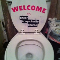 Photo taken at Cheer Up Charlie's by Katie R. on 3/13/2011