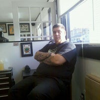 Photo taken at American Beauty Tattoo Parlor by Opie O. on 12/9/2011