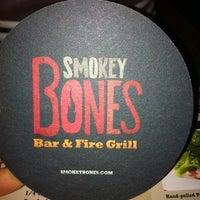 Photo taken at Smokey Bones Bar & Fire Grill by Karen D. on 9/3/2011