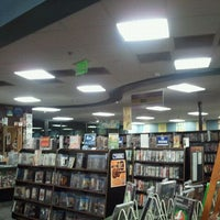 Photo taken at Bookmans by Tom S. on 4/10/2011