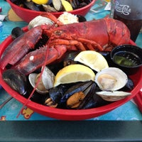 Photo taken at Gilligan's Clam Bar and Grill by Melissa F. on 5/19/2012