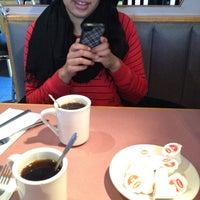 Photo taken at Station Cafe by Deryck L. on 12/18/2011