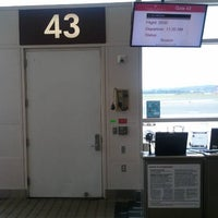 Photo taken at Gate 43 by Craig T. on 6/27/2011