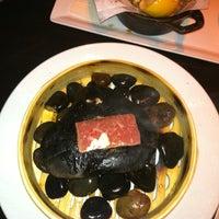 Photo taken at Brand Steakhouse & Lounge by Eduardo P. on 7/21/2011