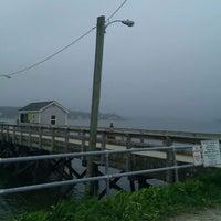 Photo taken at Great Diamond Island Dock by Travis M. on 5/21/2011