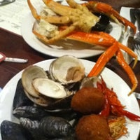 Photo taken at Phillips Seafood by Henry D. on 7/29/2012
