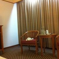 Photo taken at Diamond Plaza Hotel by Kanok L. on 4/8/2011