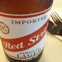 Photo taken at Islander Bar & Grill by Matthew B. on 3/22/2012