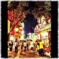 Photo taken at 北京路步行街 Beijing Road Pedestrian Street by Tjin S. on 8/28/2012