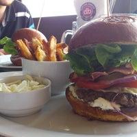 Photo taken at Domyno Burger Bar by Libor K. on 6/29/2012