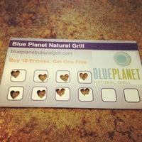Photo taken at Blue Planet Natural Grill by Kate D. on 3/7/2012