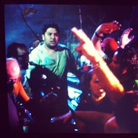 Photo taken at Treasure Island Bar by Erik H. on 3/18/2012