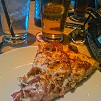 Photo taken at BJ's Restaurant and Brewhouse by Teresa H. on 7/18/2012