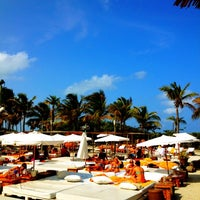Photo taken at Nikki Beach Miami by Louis P. on 5/13/2012