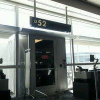 Photo taken at Gate D52 by Stephanie S. on 4/10/2012