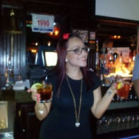 Photo taken at Burke's Bar by Eric A. on 2/4/2012