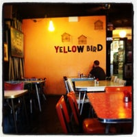 Photo taken at Yellow Bird Cafe by Chloe O. on 3/23/2012